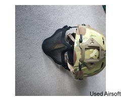 Multicam helmet with face protector attachment