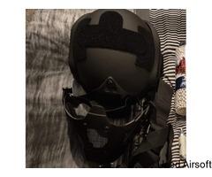Tactical vest and helmet.