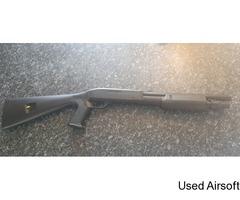 Spring powered Tri shot pump shotgun