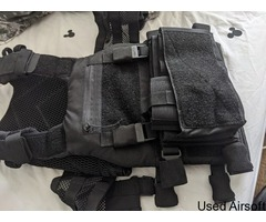 Viper tactical vest with front pouches and pistol holster
