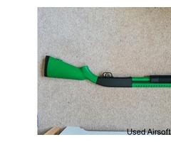 Two-Tone Green Spring Pump Shotgun.